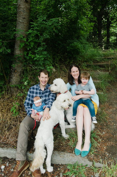 Dr. Corinne and Dr. Grant from Queen Anne Family Dental smiling with their family and dogs in Seattle, WA