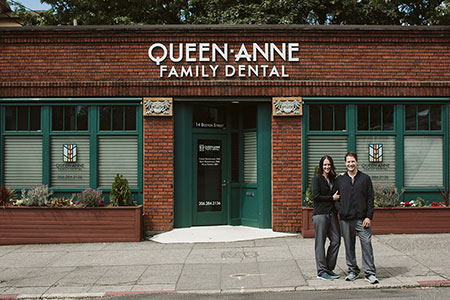 Dr.Corinne and Dr.Grant in front of Queen Anne Family Dental in Seattle, WA