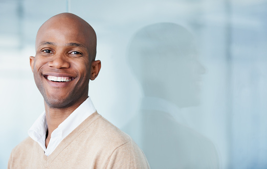 Image of a man smiling after his dental bonding treatment at Queen Anne Family Dental.